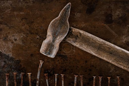Photo for Flat lay with vintage hammer and nails on rusty tabletop - Royalty Free Image