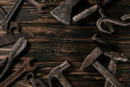 Photo for Flat lay with assortment of vintage rusty carpentry tools on wooden surface - Royalty Free Image