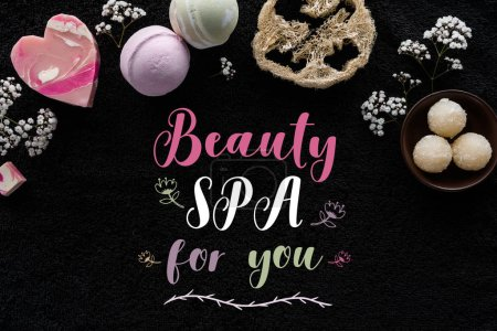 top view of spa accessories and inscription beauty spa for you on black