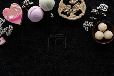 top view of spa and body care accessories on black background