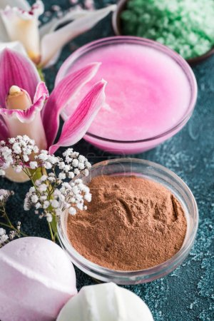 close-up view of beautiful tender flowers, homemade soap and lotion, spa treatment concept