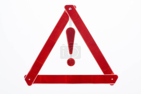 top view of red warning triangle road sign isolated on white