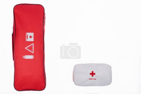 flat lay with automotive handbag and first aid kit isolated on white