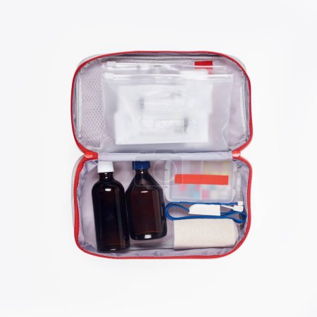 Photo for Top view of automotive first aid kit with different medicines isolated on white - Royalty Free Image