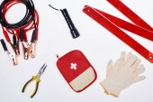 flat lay with first aid kit and automotive accessories isolated on white