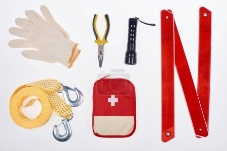 Photo for Flat lay with first aid kit and automotive accessories isolated on white - Royalty Free Image