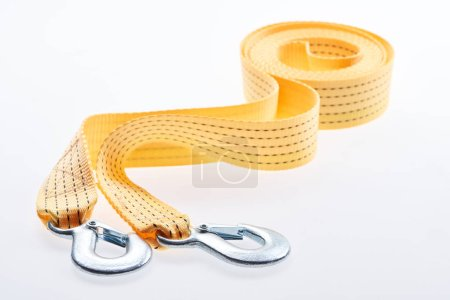close up view of yellow car tow rope isolated on white