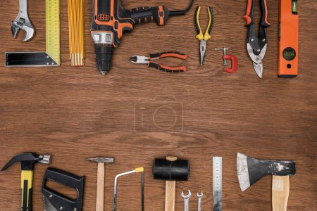top view of arranged various tools on wooden surface