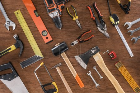Photo for Top view of arranged various tools on wooden table - Royalty Free Image