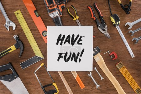 Photo for Top view of paper with lettering have fun near arranged various tools on wooden table - Royalty Free Image