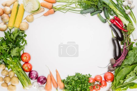 Photo for Flat lay with fresh autumn vegetables arranged with blank space in middle isolated on white - Royalty Free Image