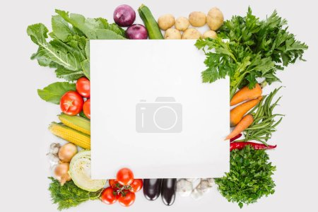 top view of food composition with fall harvest with blank space in middle isolated on white