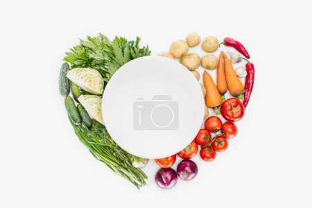 Photo for Top view of autumn harvest arranged in heat shape with empty plate in middle isolated on white - Royalty Free Image