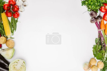 Photo for Top view of food composition with various seasonal ripe vegetables isolated on white - Royalty Free Image