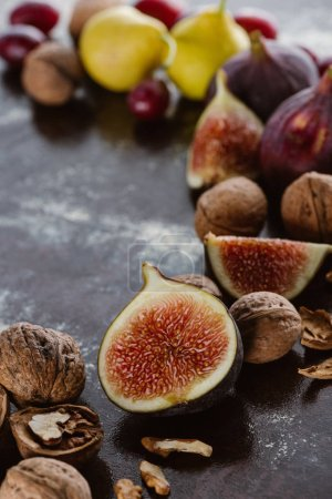 Photo for Close up view of figs and hazelnuts arranged on tabletop - Royalty Free Image