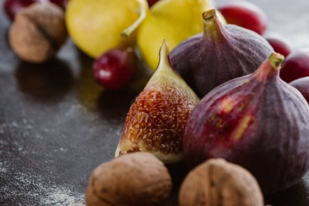 close up view of figs, pears and hazelnuts arranged on tabletop