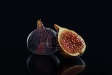 close up view of fresh figs on black background