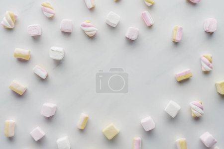top view of tasty colored marshmallows on white surface