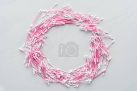 top view of cotton swabs in shape of circle isolated on white, beauty concept