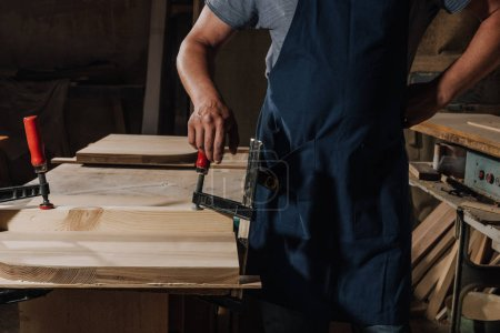Photo for Partial view of woodworker standing akimbo at wooden workshop - Royalty Free Image
