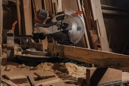 close up view of circular saw and wooden planks at wooden workshop