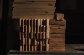 close up view of arranged wooden planks at wooden workshop