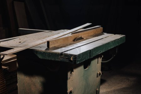 close up view of circular saw and materials at wooden workshop