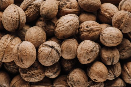 Photo for Top view of walnuts in nutshells in full screen - Royalty Free Image
