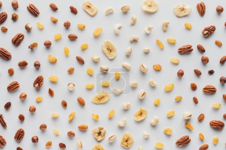 flat lay with mix of dried fruits and nuts isolated on white background