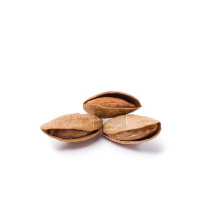 handful of almonds in nutshells isolated on white background