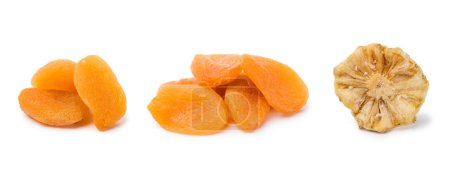 handfuls of dried apricots and pineapple isolated on white background