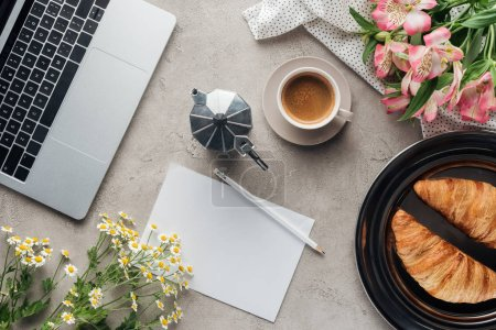 Photo for Top view of cup of coffee with blank paper, croissants and flowers on concrete surface - Royalty Free Image