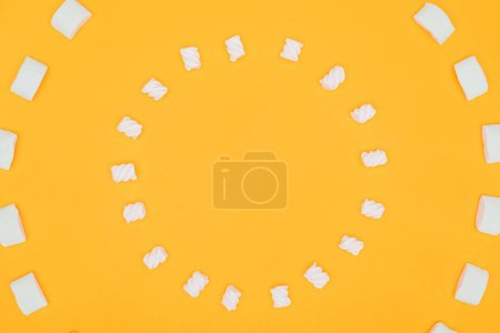 top view of circles of tasty marshmallows isolated on orange