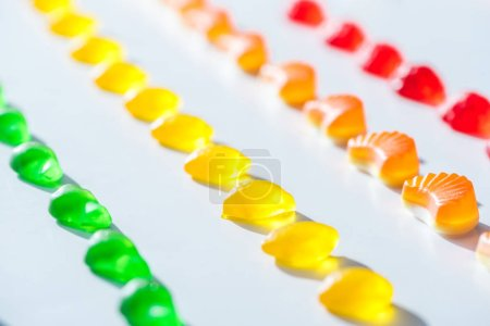 set of sweet green, yellow and red jelly candies on white