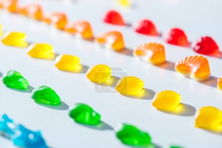 set of sweet colored jelly candies on white