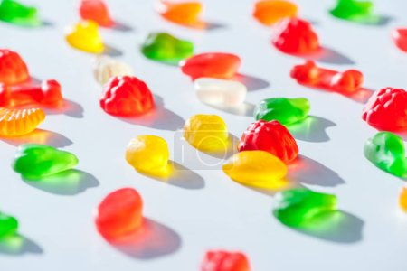 Photo for Tasty bright jelly candies on white surface - Royalty Free Image