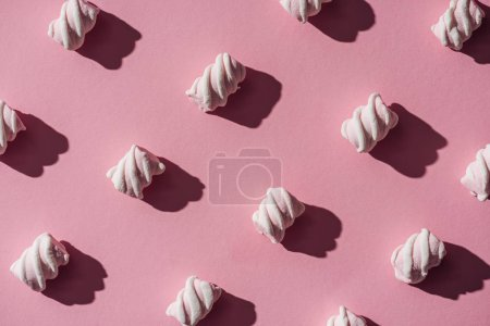 collection of delicious marshmallows with shadows on pink