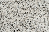 abstract texture of light marble stone with black dots