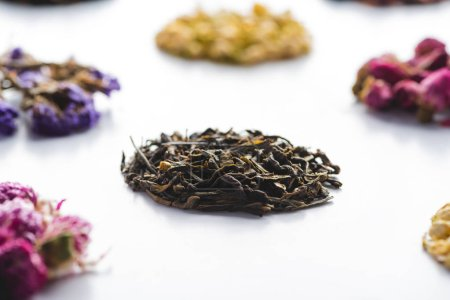 collection of organic herbal dried tea on white tabletop
