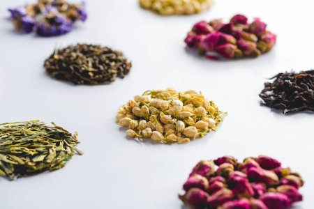 collection of dried herbal healthy tea on white surface