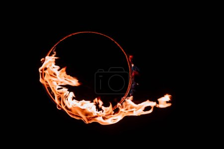 close up view of burning circle figure isolated on black