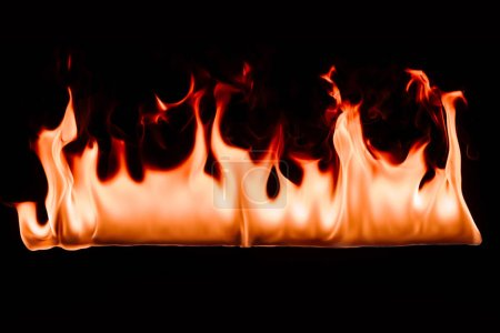 close up view of burning fire on black backdrop
