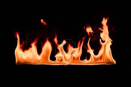 close up view of burning orange flame on black backdrop
