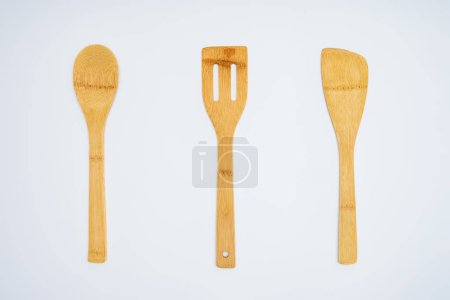 top view of arranged wooden kitchen utensils isolated on grey