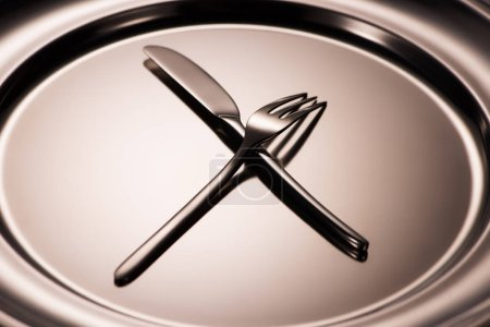 Photo for Close-up view of shiny fork and knife arranged on metal tray - Royalty Free Image