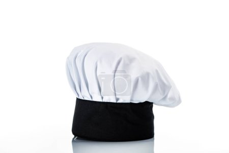 close-up view of single black and white chef hat on white