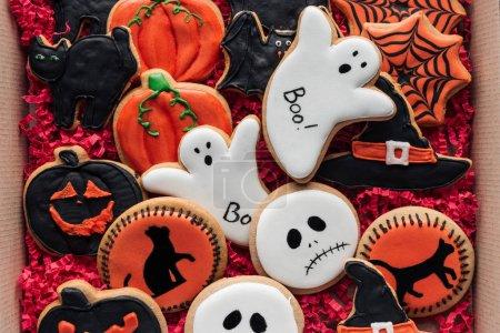 top view of cardboard box with homemade spooky halloween cookies