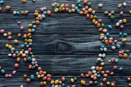 Photo for Circle made of colorful delicious candies on wooden background - Royalty Free Image