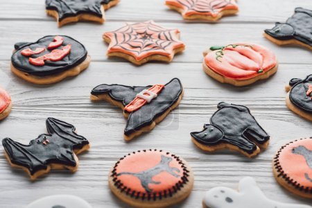 close up view of arranged homemade halloween cookies on wooden table