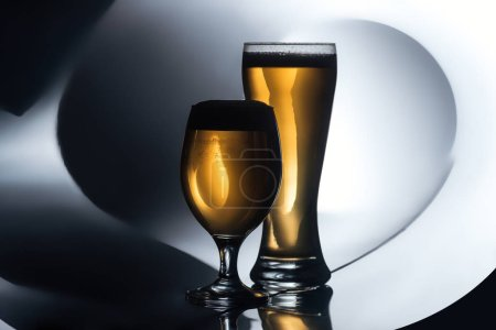 glasses of beer on white and black background, oktoberfest concept
